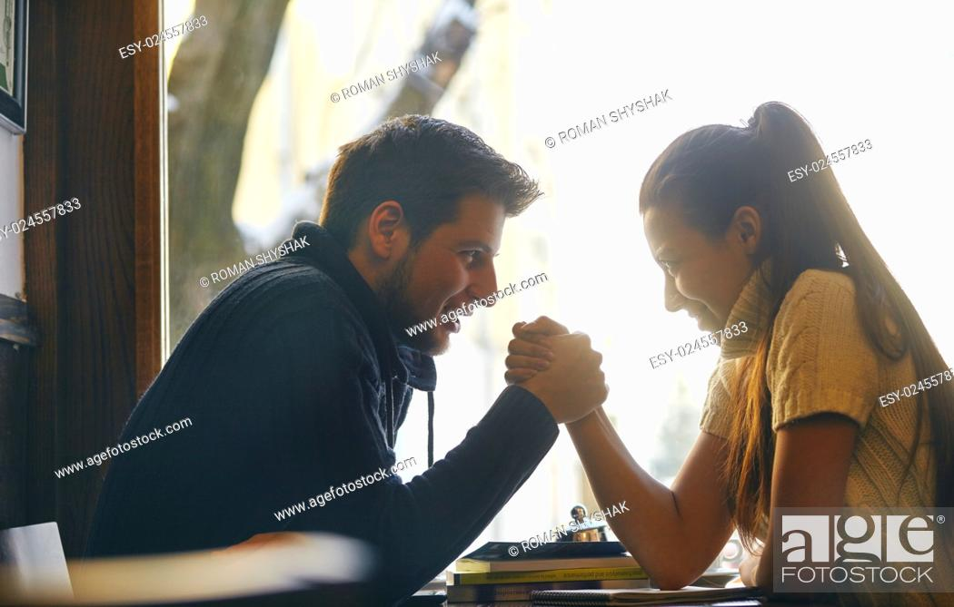 Stock Photo: Young couple in the cafe holding their hands.