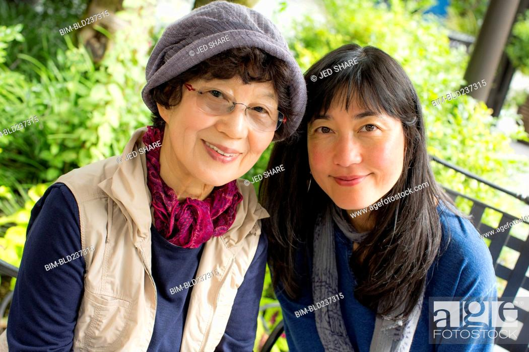 Stock Photo: Portrait of smiling older Japanese mother and daughter.