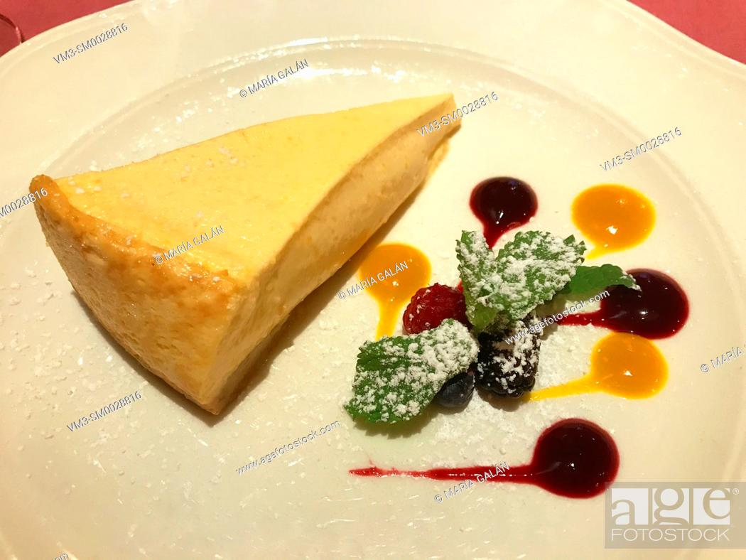 Stock Photo: Cheese cake with mango and raspberry jam and mint leaves.