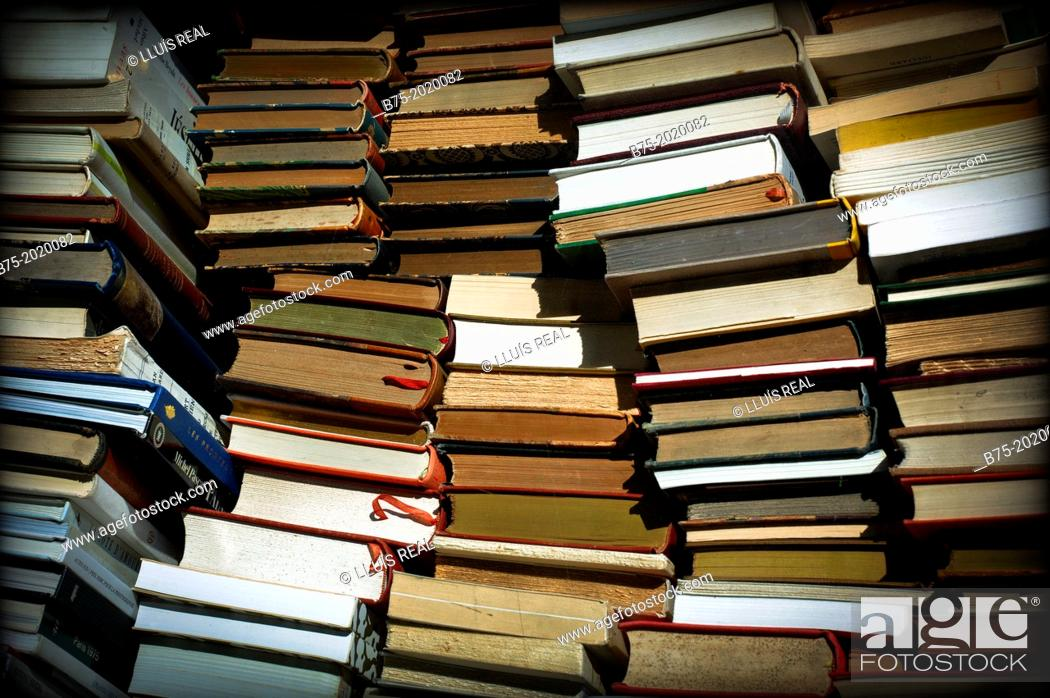Stock Photo: group of books stacked and disordered.