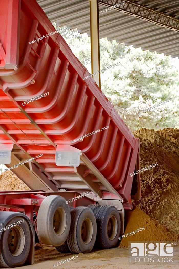 Stock Photo: Unloading sand.
