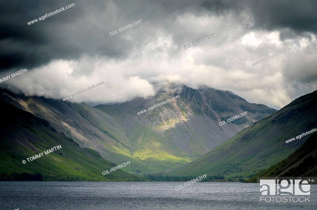 Stock Photo: Storm clouds over Goat Crag across Buttermere lake, The Lake District , UK.