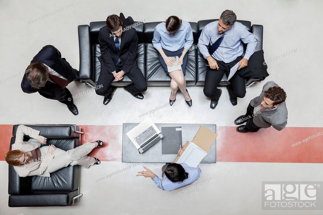 Stock Photo: Executives in meeting, overhead view.