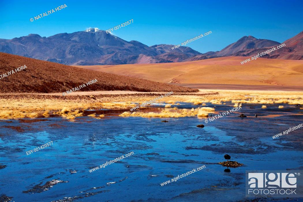 Stock Photo: active volcano Putana also known as Jorqencal or Machuca near Rio Putana, Chile.