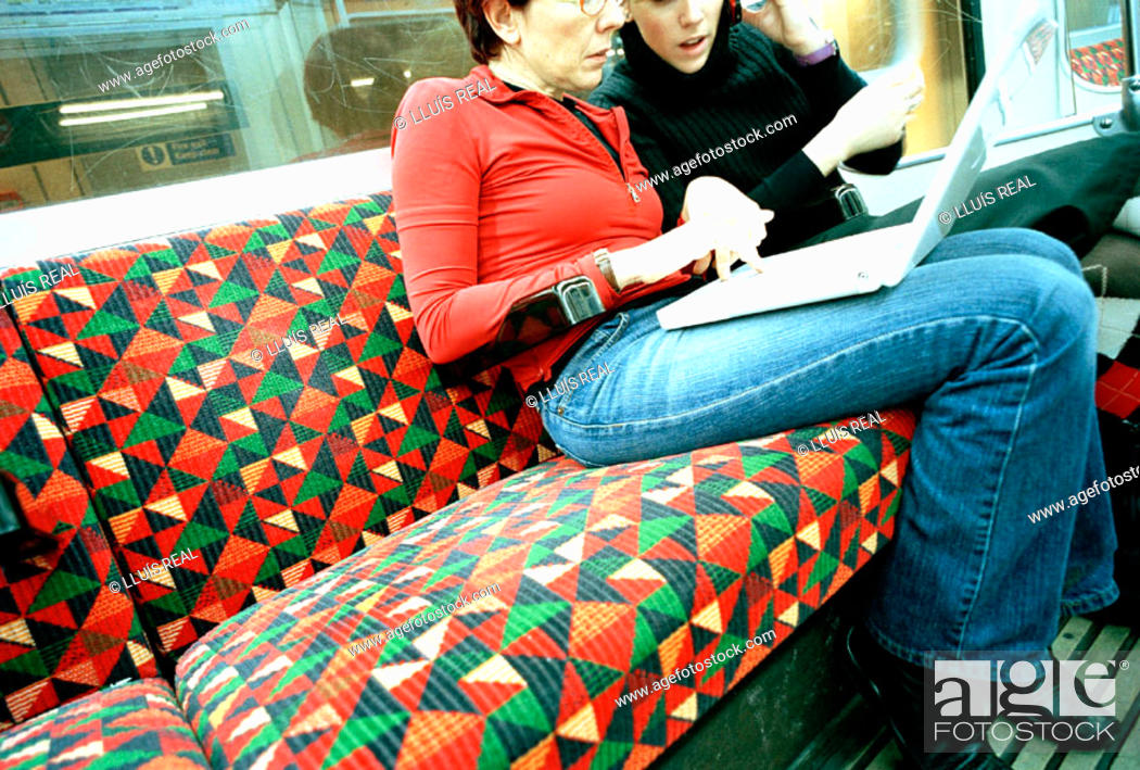 Stock Photo: Women with laptop in the tube.