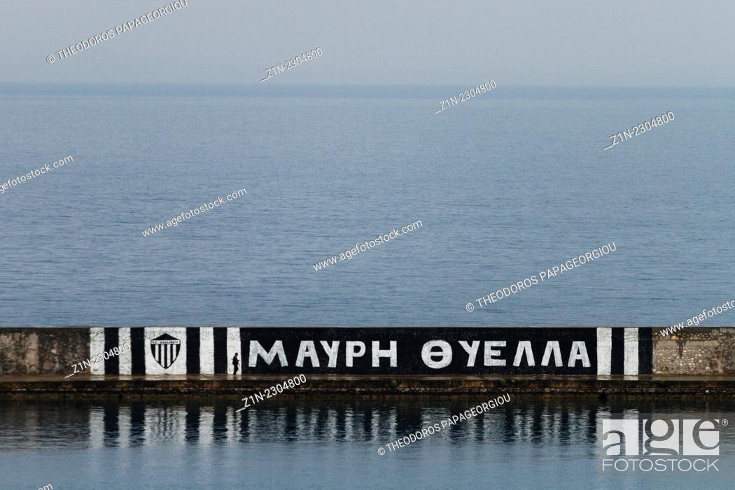 Stock Photo: Footbal slogan (Black Storm) painted on the jetty of Kalamata's harbour. Messenia, Peloponnese, Greece.