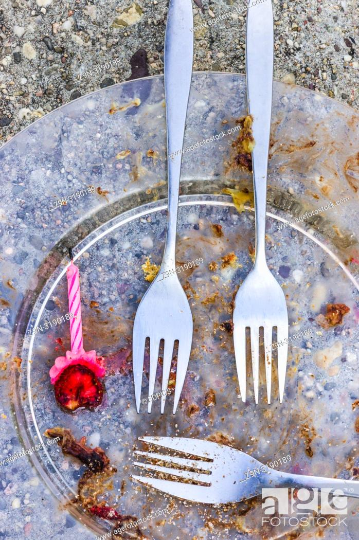 Stock Photo: leftovers of a party, plate forks and candle forgotten in a park, stuttgart, baden-wuerttemberg, germany.