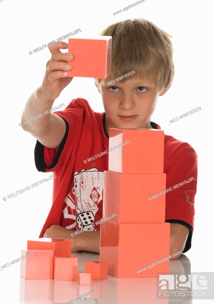 Stock Photo: Boy 8-9 playing with building bricks.