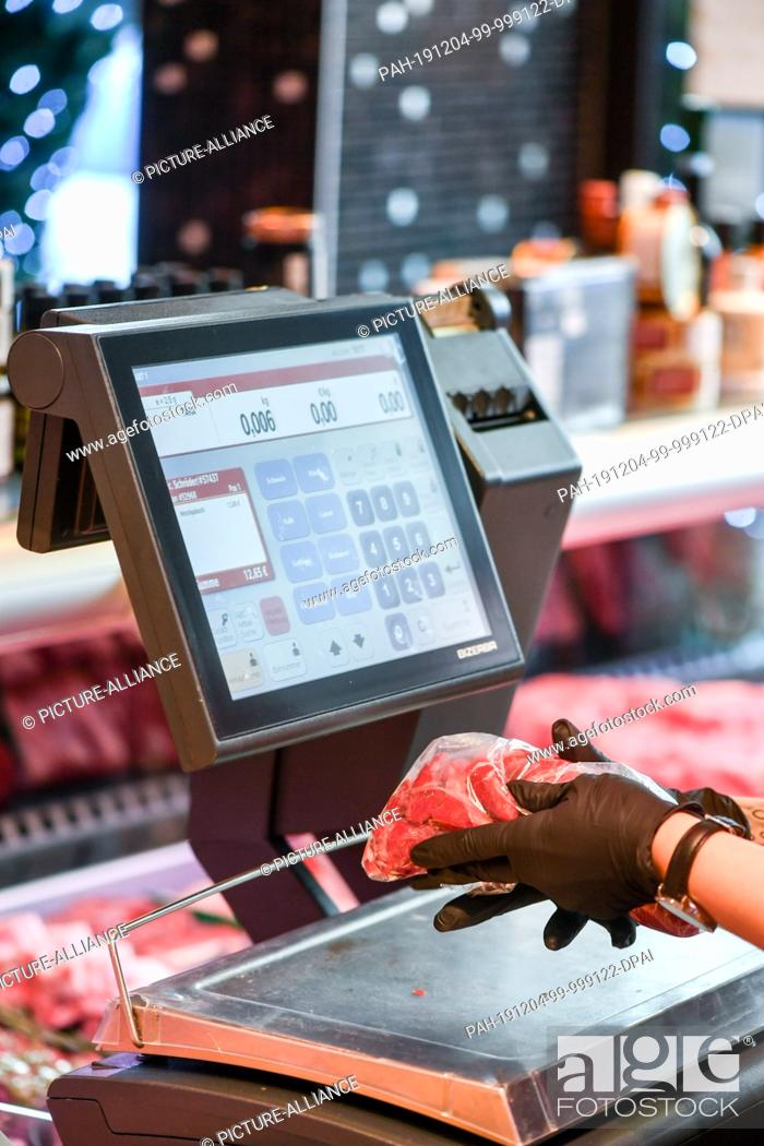 Stock Photo: 03 December 2019, Berlin: A scale in the Jens-Uwe Bünger butcher's. Photo: Jens Kalaene/dpa-Zentralbild/ZB - ATTENTION: Only for editorial use in connection.
