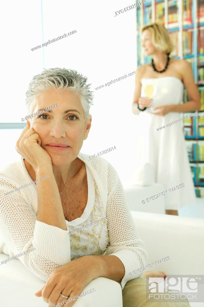 Stock Photo: Two women inside a living room.