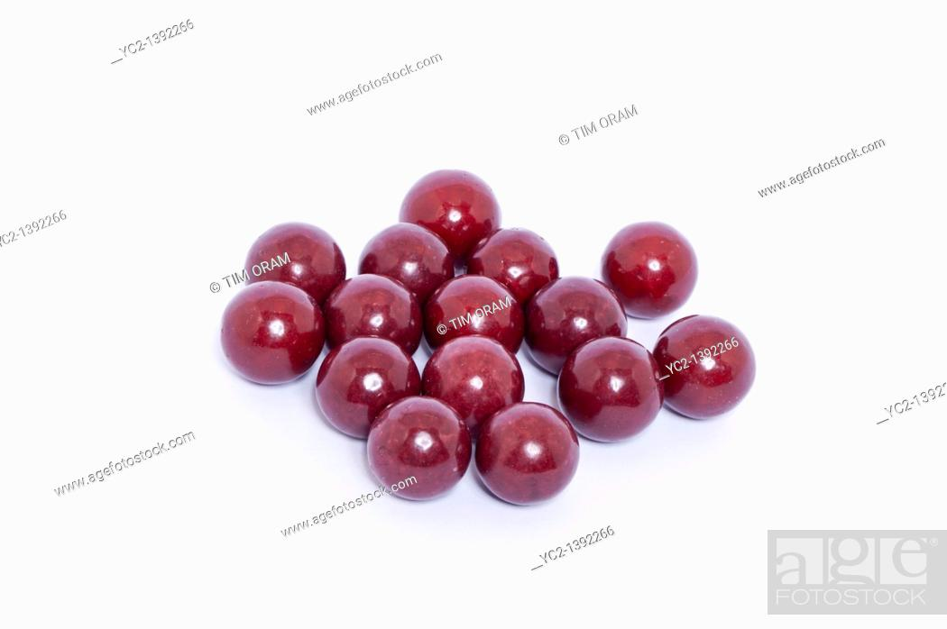 Stock Photo: A selection of aniseed balls traditional sweets on a white background.