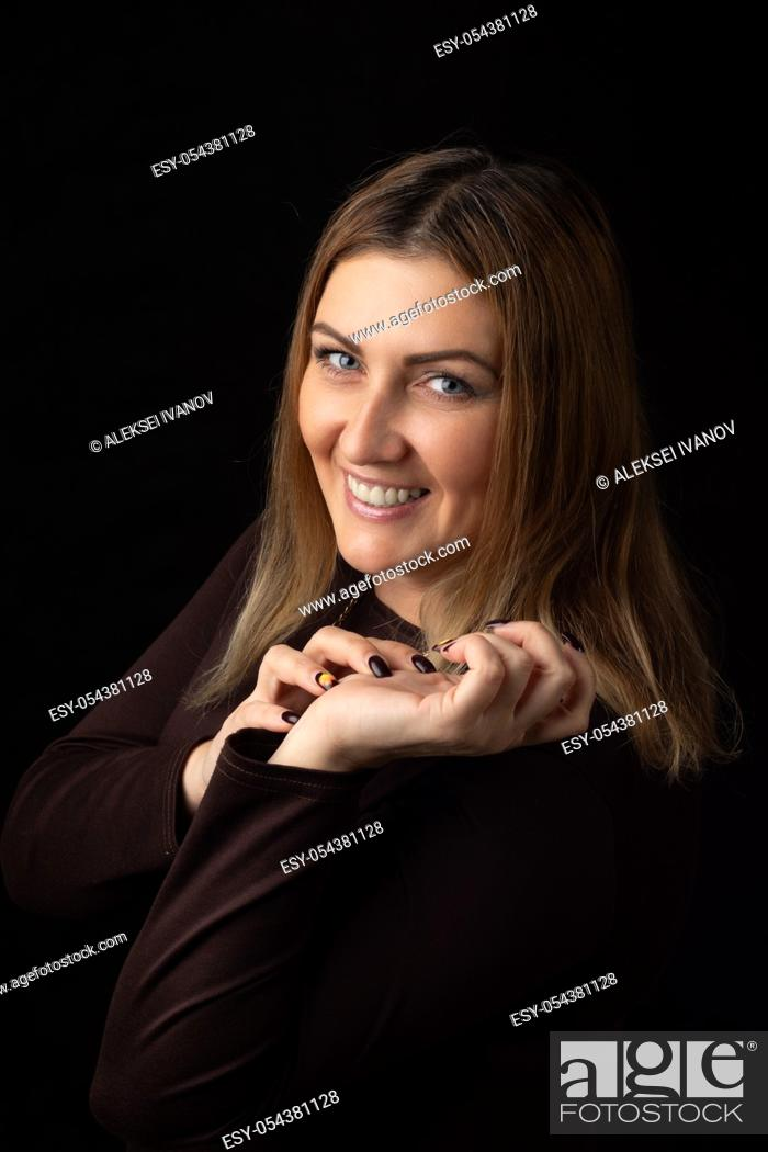 Stock Photo: Portrait of a smiling thirty-year-old girl of European appearance.