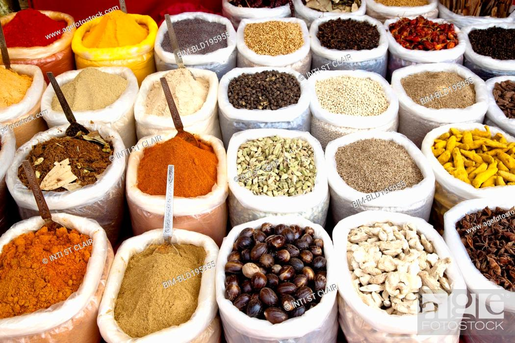 Stock Photo: Variety of colorful Indian spices in sacks.