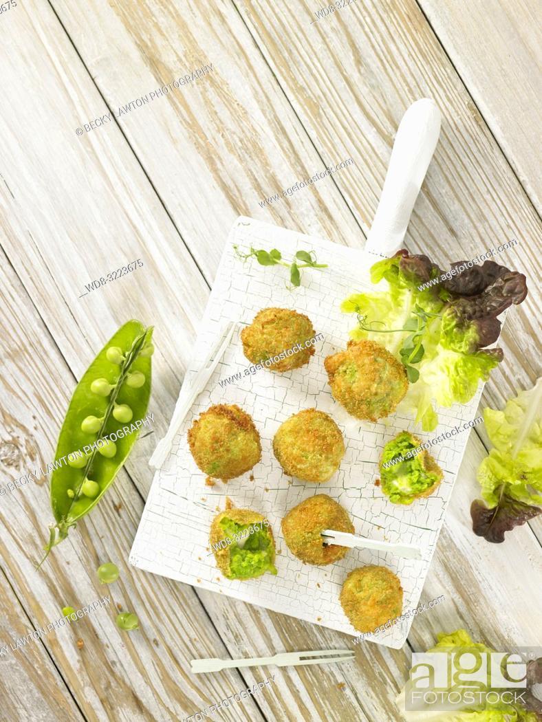 Stock Photo: croquetas de guisantes con lechuga / Pea croquettes with lettuce.