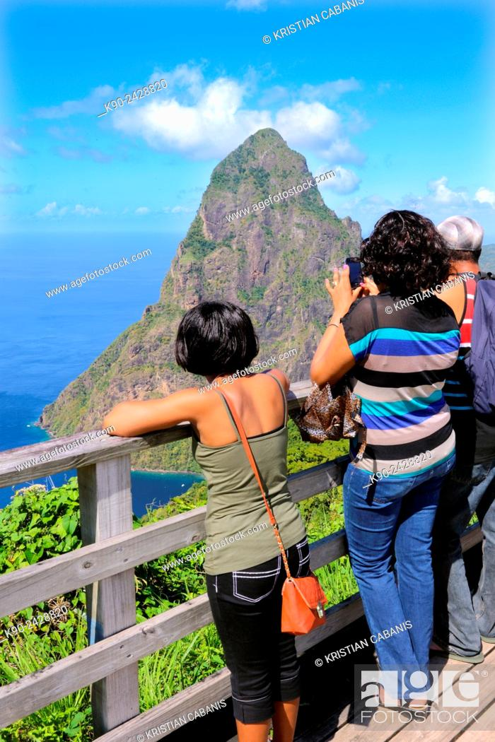 Stock Photo: Tourists standing on a platform and enjoying the vista of the granite cone of Petit Piton and the Caribbean Sea, St Lucia, Windward Islands, Lesser Antilles.
