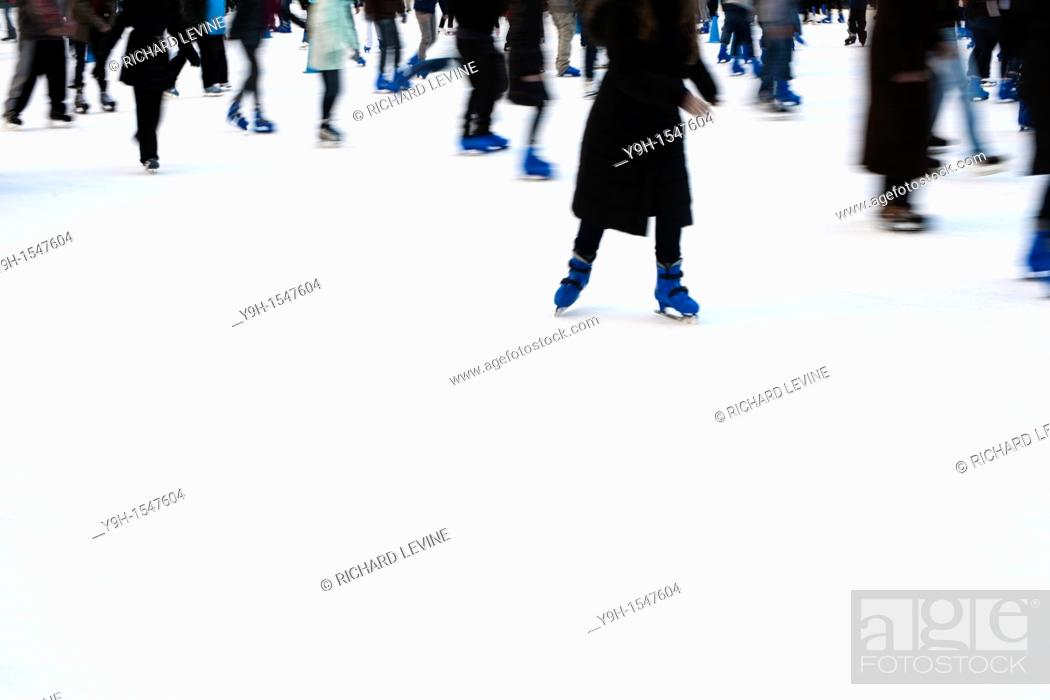 Stock Photo: Skaters maneuver the packed Pond at Bryant Park ice skating rink in New York.