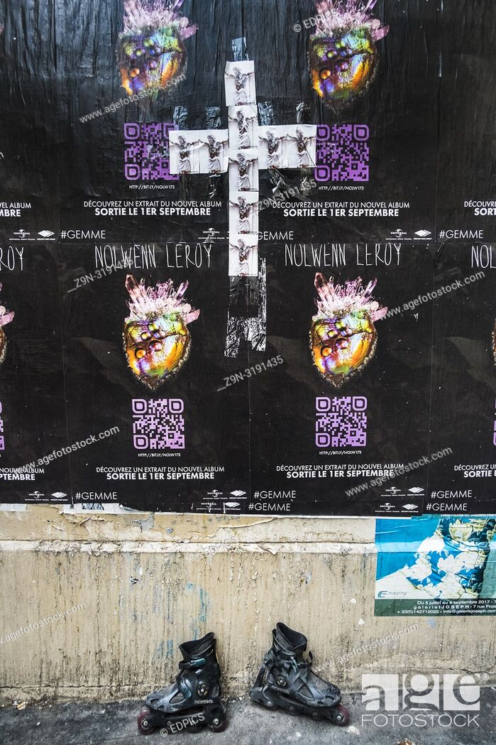 Stock Photo: posters for nolwenn leroy album and photograhs of crucified jesus christ forming a cross, inline skates, paris, ile de france, france.