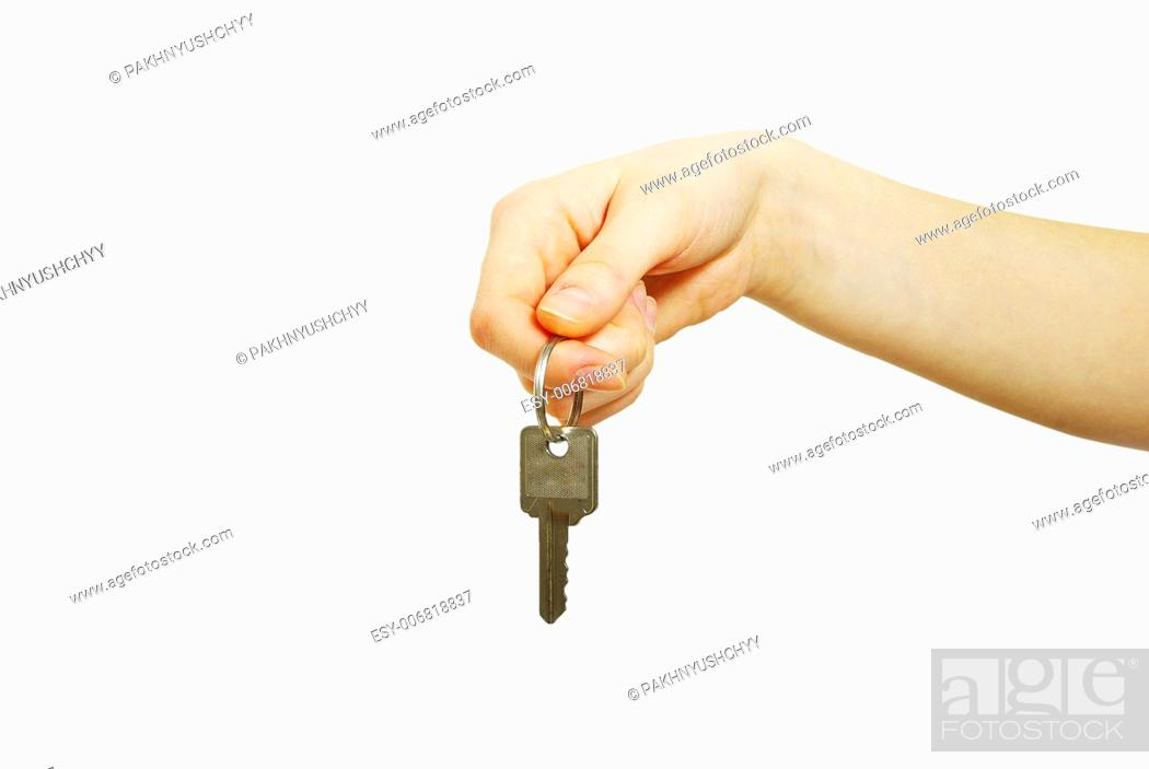 Photo de stock: hand holds a key isolated on white.