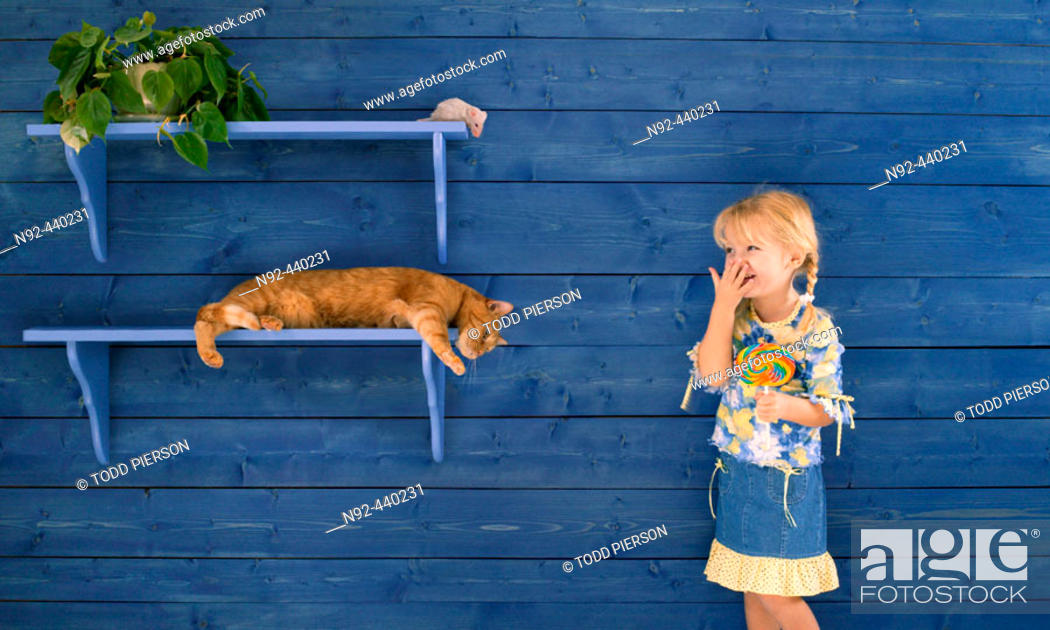 Stock Photo: 4 year old girl. Trained cat. Fake mouse.