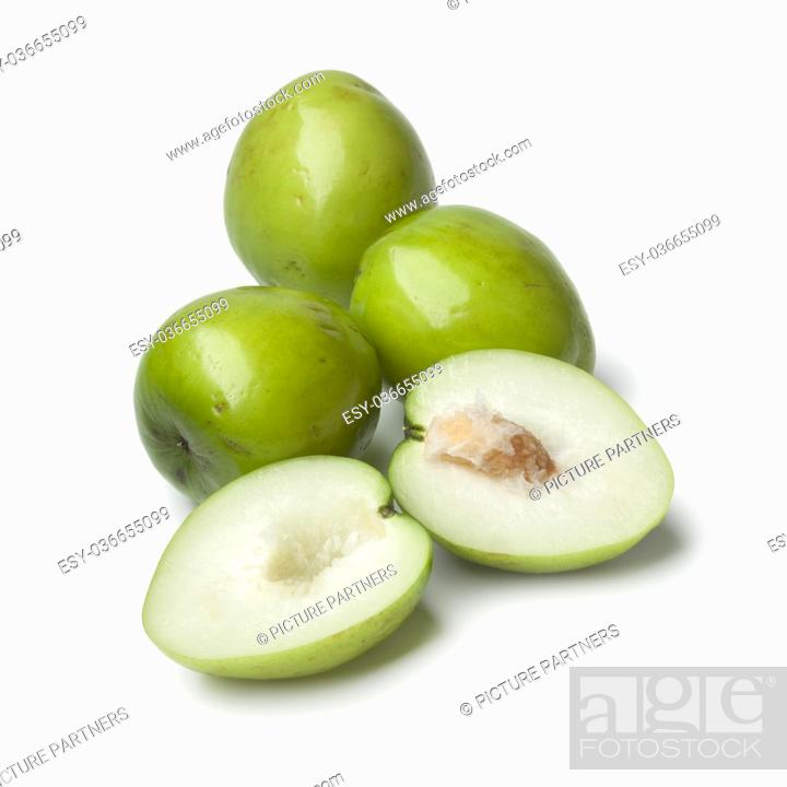 Stock Photo: Fresh green whole and half Ambarella fruit with a fibrous pit on white background.