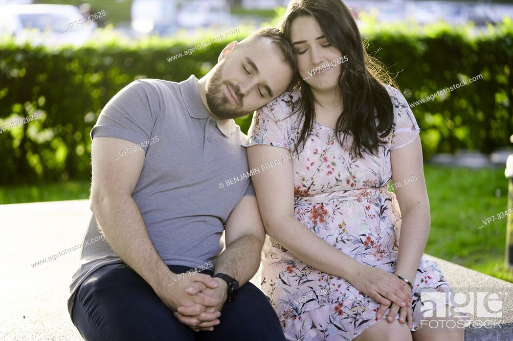 Stock Photo: content couple leaning on each other in park, soulmates.