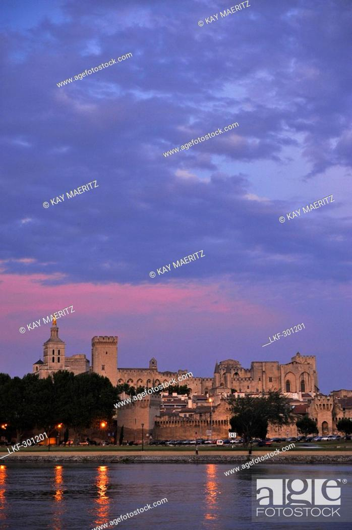 Stock Photo: View over river Rhone to city walls, cathedral Notre-Dame-des-Doms and papal palace in the afterglow, Avignon, Vaucluse, Provence, France, Europe.