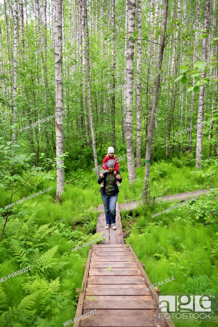Stock Photo: Finland, Kuopio, mother and daughter walking in a birch forest.