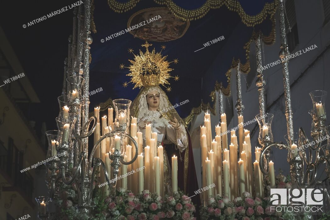 Stock Photo: Virgen Maria in procession in Marbella at the holy week , candles an throne at night in Spain.