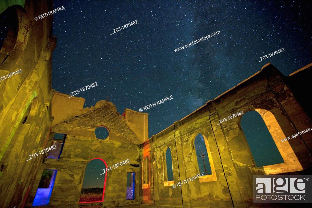Stock Photo: Old ruined mission at night with the Milky Way showing in southern Colorado, USA.
