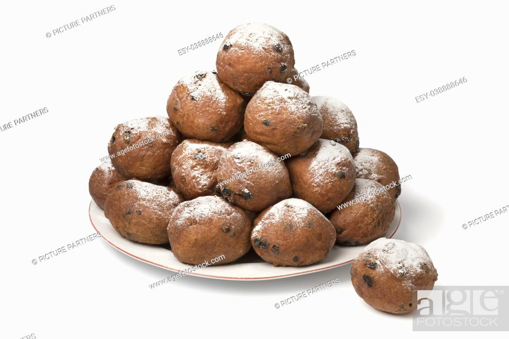 Stock Photo: Dish with oliebollen, traditional Dutch pastry for New Year's Eve isolated on white background.