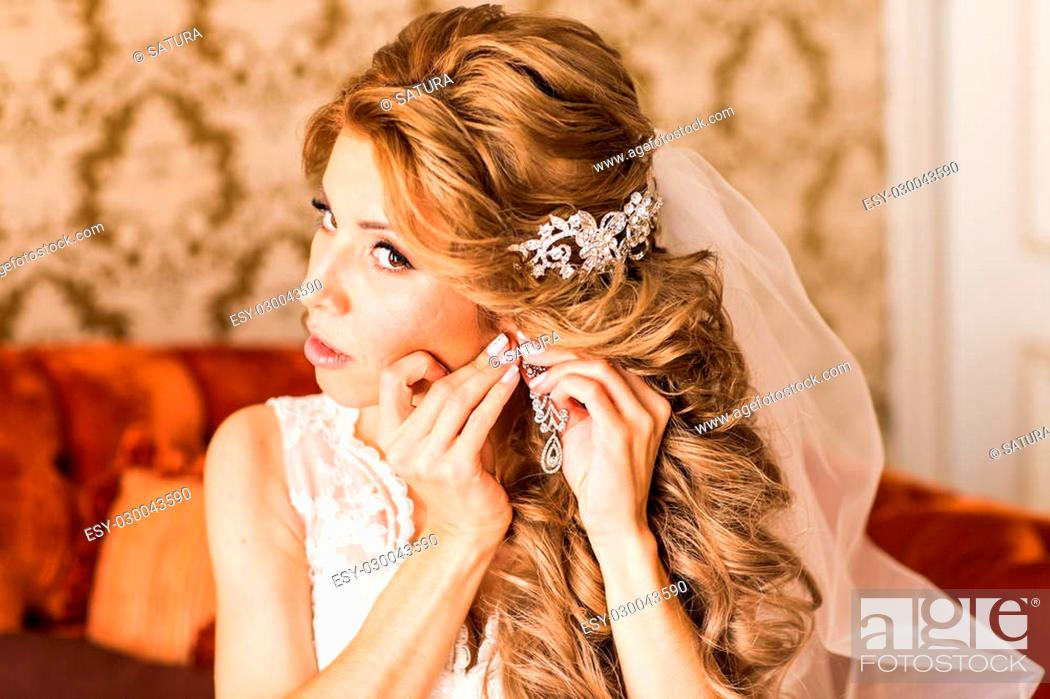 Stock Photo: Young beautiful Bride preparing to wedding ceremony.