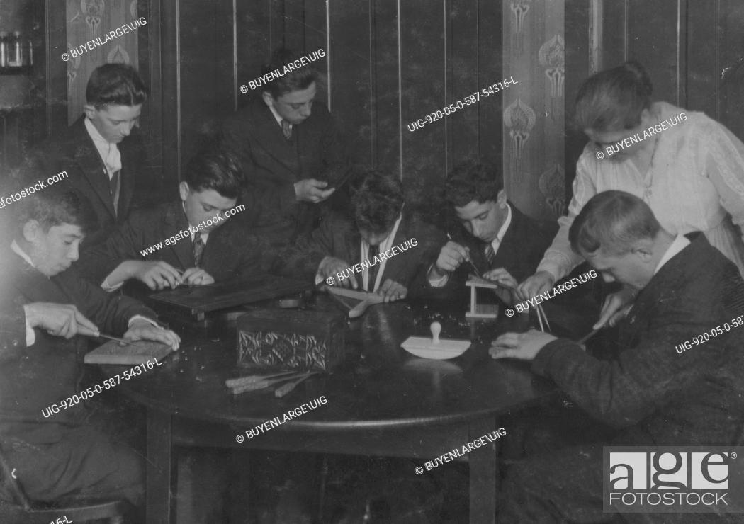 Stock Photo Wood Carving Group Of Working Boys At King Philip Settlement
