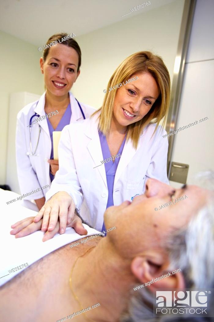 Stock Photo: Doctor and nurse with patient in a hospital room. Hospital Policlinica Gipuzkoa, San Sebastian, Donostia, Euskadi, Spain.