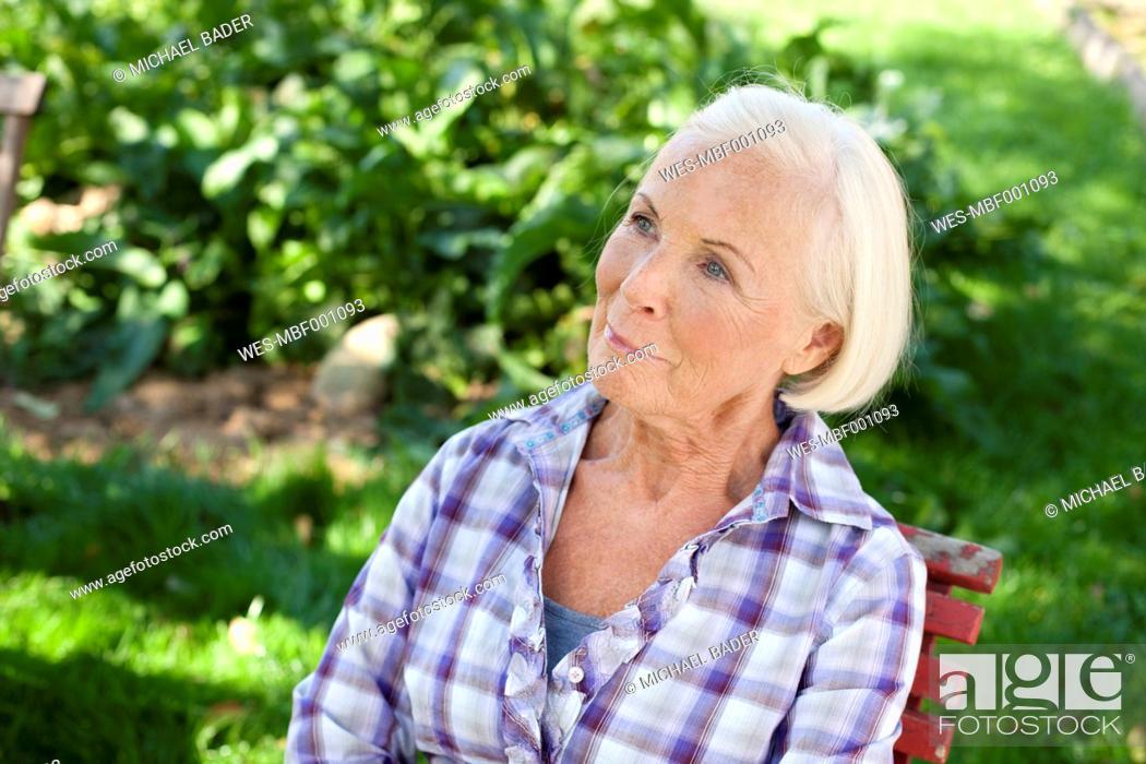 Stock Photo: Germany, Saxony, Senior woman relaxing at the farm.