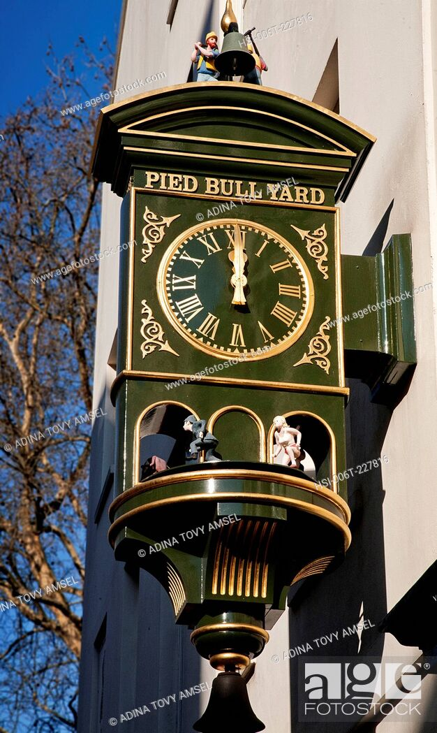 Stock Photo: UK. England. London. Close-up of clock outside Pied Bull Yard.