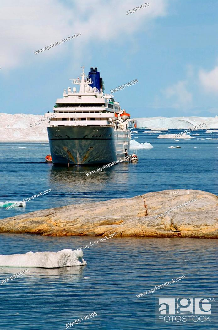Stock Photo: cruiseship off the coast of Greenland with Icebergs in the background, Greenland.