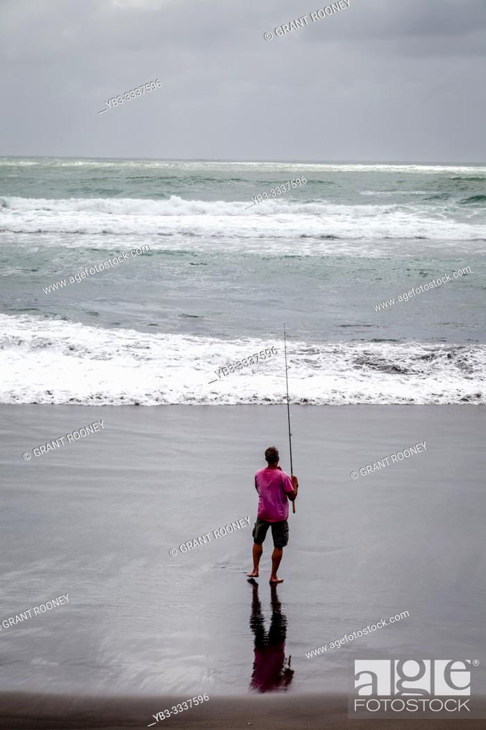 Stock Photo: A Fisherman On Hot Water Beach (Ocean Beach), Kawhia, North Island, New Zealand.