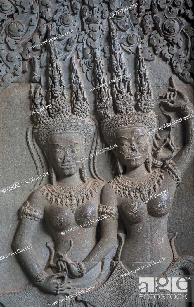 Stock Photo: Aspara sculptures in bas-relief on the wall, in Angkor Wat, Siem Reap, Cambodia.