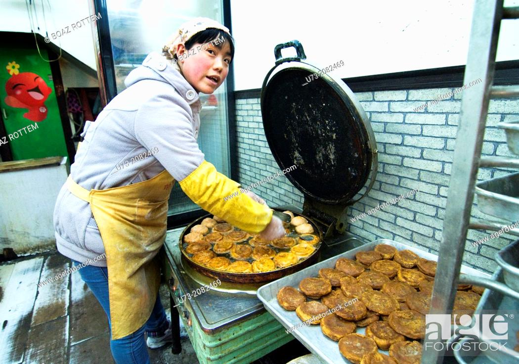 Stock Photo: Persimmon cakes Shi zi bing, a local specialty from Xian, China.