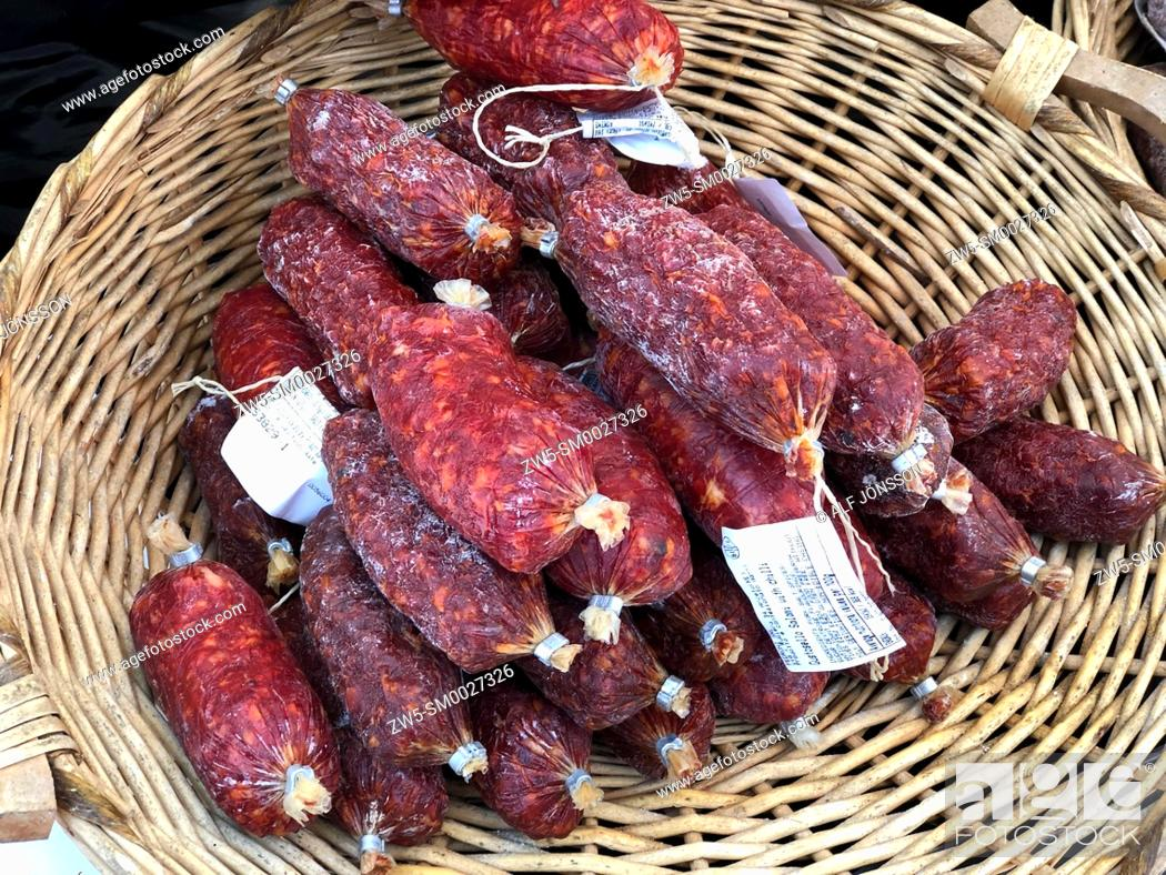 Stock Photo: Italian salami in a basket on a market.
