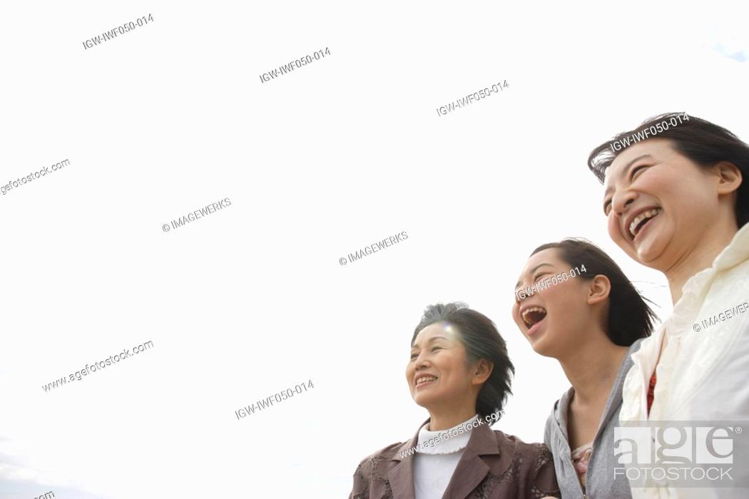 Stock Photo: Daughter 14-15 with mother and grandmother, smiling.