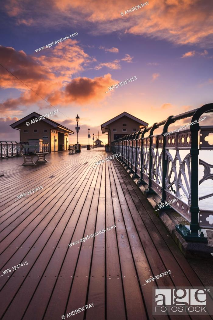 Stock Photo: Sunrise captured from the Victorian Pier at Penarth in South Wales, using a wide angle zoom lens on a morning in mid February.