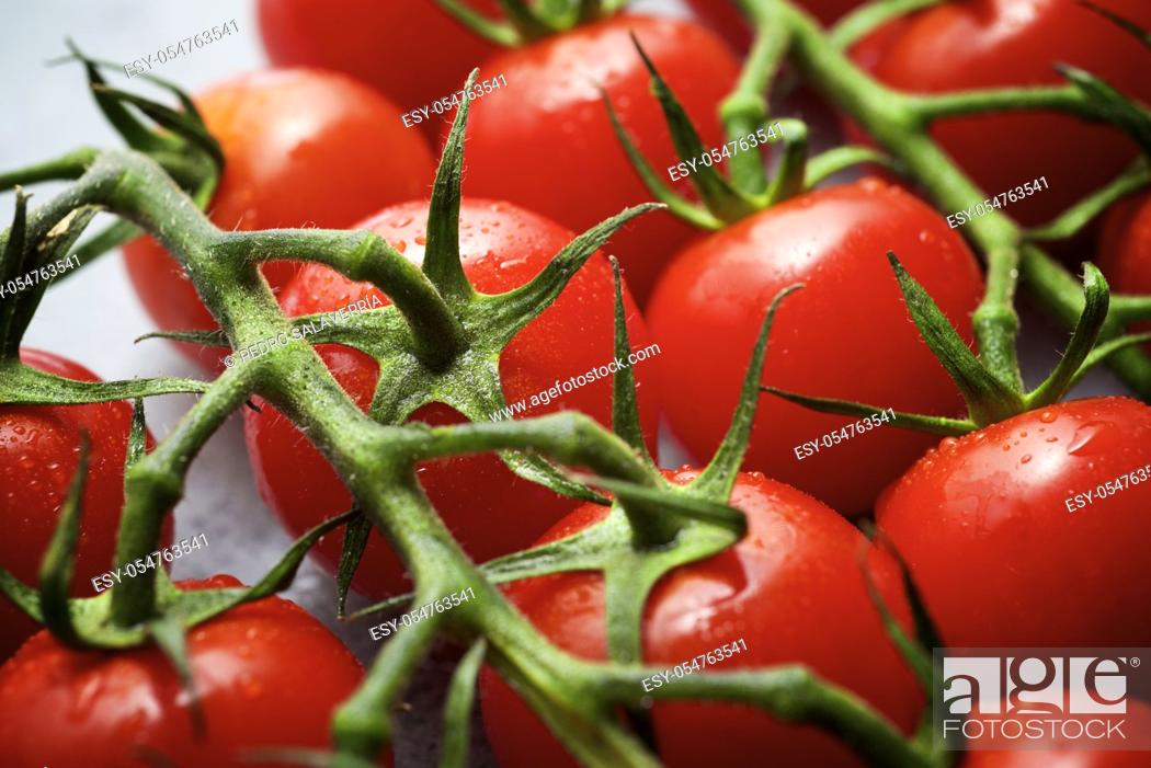 Stock Photo: Cherry tomatoes on a gray table.