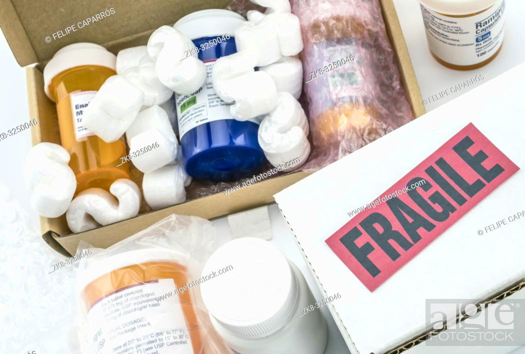 Stock Photo: Several bottles of medication in boxes, conceptual image.