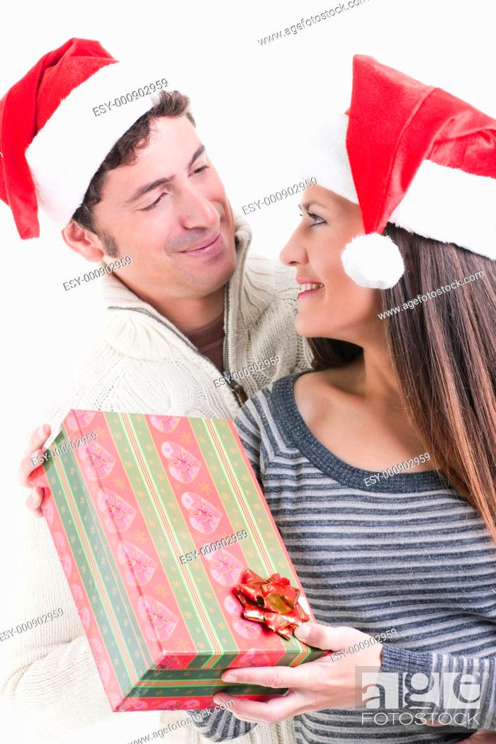 Stock Photo: Happy couple holding a Christmas gift.