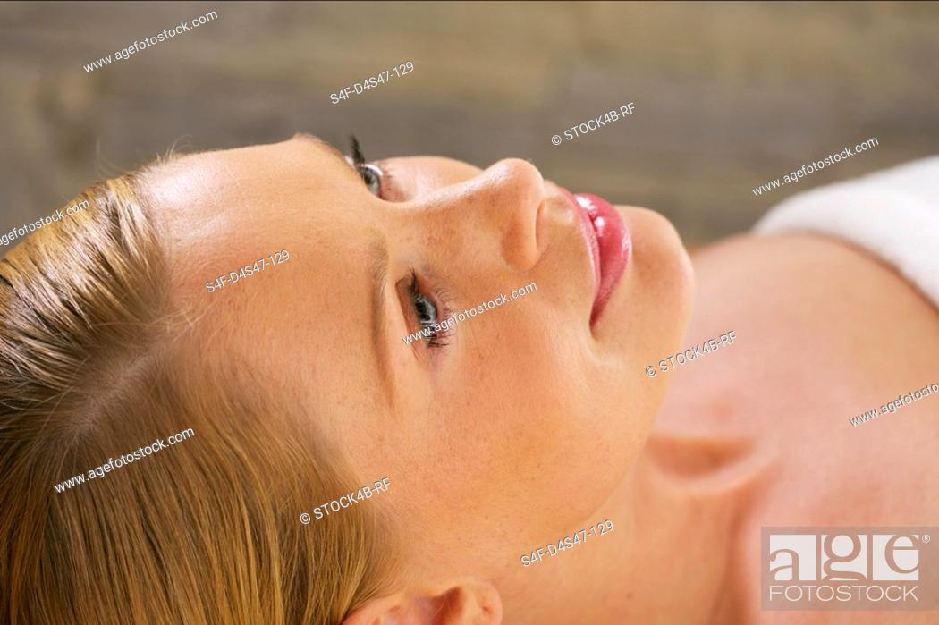 Stock Photo: Smiling woman looking up.