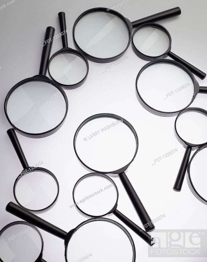 Stock Photo: Magnifying glasses over white background.