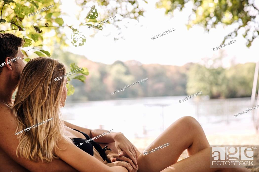 Stock Photo: Young couple enjoing summer at the lake.