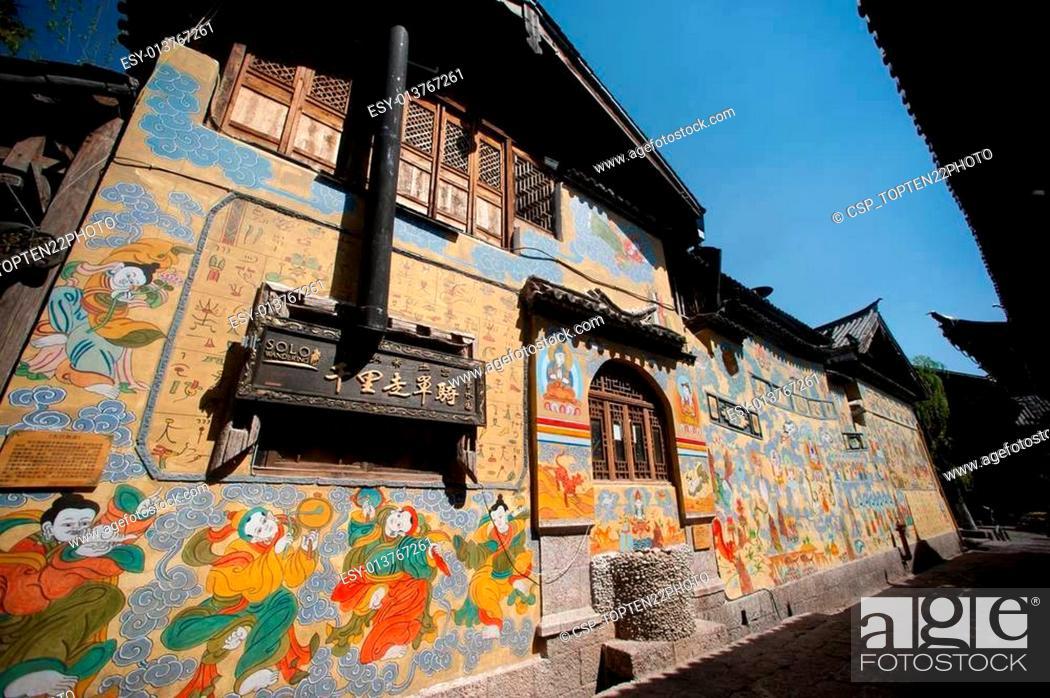 Stock Photo: Tibetan art murals on building wall in Dayan old town.