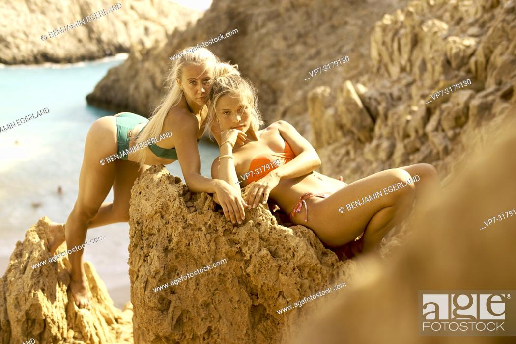 Stock Photo: two women at Seitan Limania Beach, Crete, Greece.